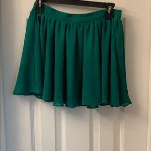 Flirty green mini skirt.